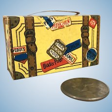 Paper suitcase candy container with amusing misprints
