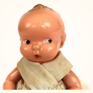 Vintage hard plastic Irwin side glancing baby doll in original clothing