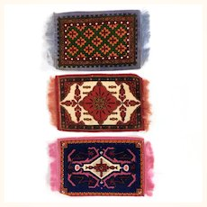 Three dollhouse tobacco felt rugs