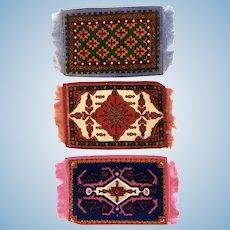 Three dollhouse tobacco felt rugs