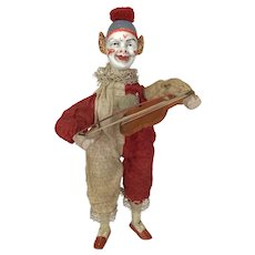 Unusual painted porcelain head clown playing fiddle