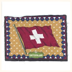 Tobacco felt rug with Swiss flag imagery