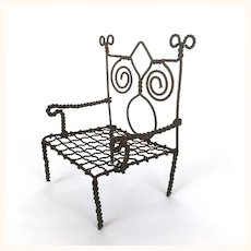 Old wire doll's chair