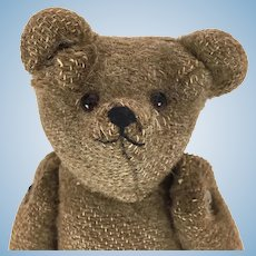 Old well loved threadbare teddy bear