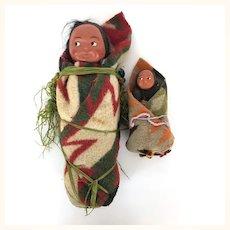 Two vintage Skookum babies papoose dolls