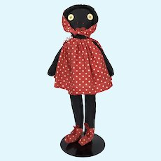 Vintage cloth black doll in adorable clothing
