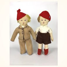 Two vintage cloth dolls brothers with extensive wardrobe