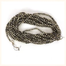 Old and tarnished silver beaded long Christmas Garland