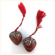 Two antique strawberry thread waxers