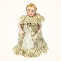 All bisque unusual dollhouse toddler with molded boots