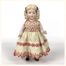 All bisque blonde German girl in embroidered dress