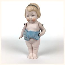 All bisque pudgy toddler with watermelon mouth and large bow