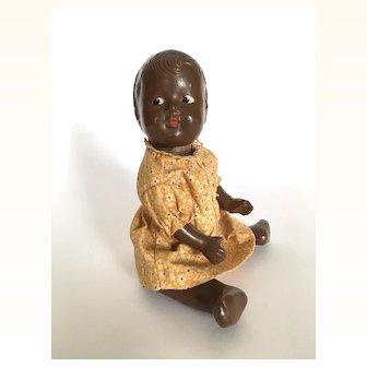 Vintage composition black baby doll