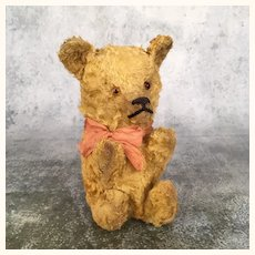 Very old well loved antique unjointed Teddy bear