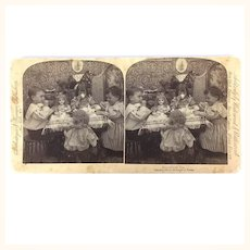 Antique sepia photo of children and doll's Tea Party