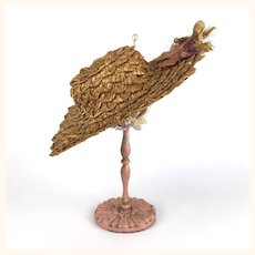 Antique straw doll's hat with asymmetrical floral trim