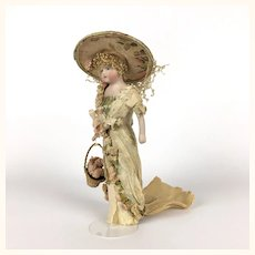 Antique fabulous bisque head lady in original crepe paper clothing with flowers