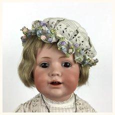 Kestner character girl, model 247 in lovely antique dress and hat