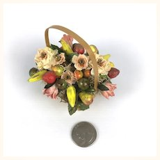 Miniature flower arrangement in vintage basket