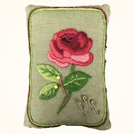 Vintage pincushion with crewel embroidery and pin design
