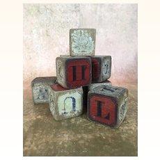 Antique partial set of alphabet blocks in wonderful beat up condition