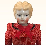 Blonde Hertwig lowbrow china doll in festive dress