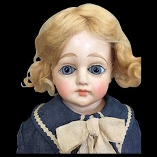 Antique papier mache girl with glass eyes and wonderful dress