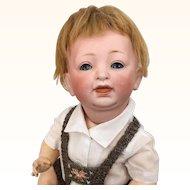 Kestner Model 211 bisque character Sammy in charming knit costume