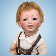 Kestner Model 211 bisque character baby in charming knit costume
