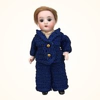 All bisque boy in blue crocheted outfit