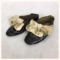 Antique two toned oilcloth doll shoes