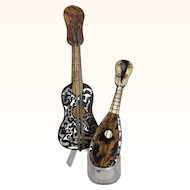 Pair of miniature musical stringed instruments