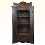 Old small wooden display cabinet with glass door and shelves
