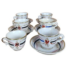Antique doll sized porcelain tea set in original French box
