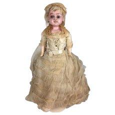 Antique wax over papier mache bride doll