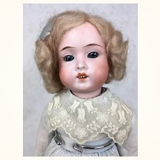German bisque girl by Schoenhau and Hoffmeister with plump face
