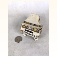 Lithographed cardboard Steinway piano candy container