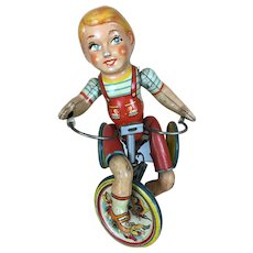 Unique Art Manufacturing Tin Lithographed boy on Tricycle
