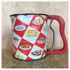 Vintage kitchen sifter with wonderful graphics