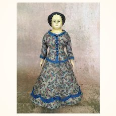 Antique small papier mache doll with flattop hairstyle