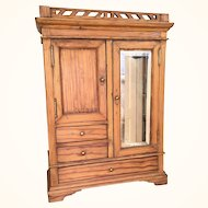 Antique oak doll's wardrobe with mirror, drawers, cabinet