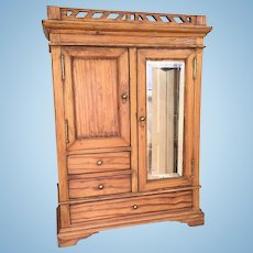 Antique oak doll's wardrobe