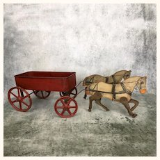 Antique toy wagon pulled by two horses