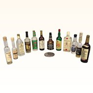 Vintage miniature dollhouse liquor bottles for a well-stocked salon