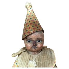 Antique wax over papier mache clown doll