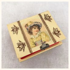 Early 1900's celluloid sewing box with lovely girl image on top