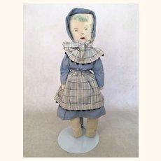 Vintage primitive cloth folk art doll with blue clothing