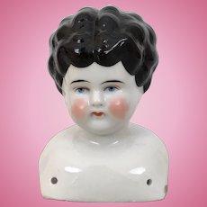 Lowbrow china doll head