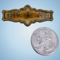 Antique celluloid and brass pin for doll