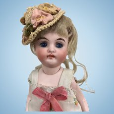 German all-bisque miniature doll with beautiful face